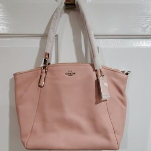 Brand new with tags blush Coach bag!